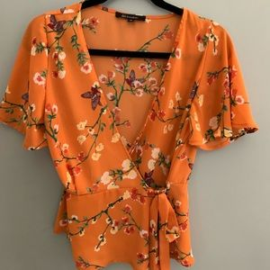 Bright orange and floral wrap shirt!